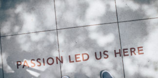 "Feet on sidewalk, with words ""passion led us here"""